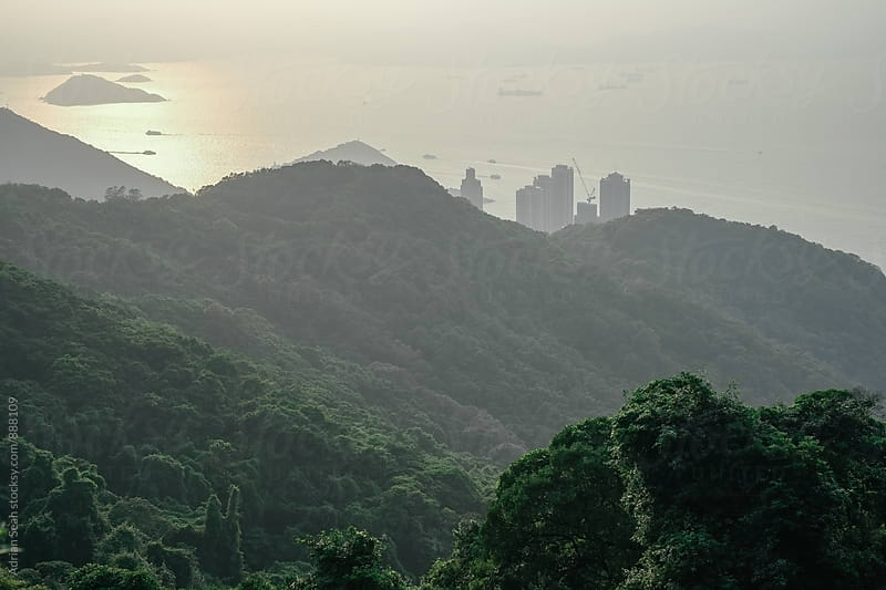 Hazy sunset in Hong Kong by Adrian Seah for Stocksy United
