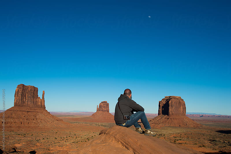 A man looks the landscape of the monument valley by Jean-Claude Manfredi for Stocksy United