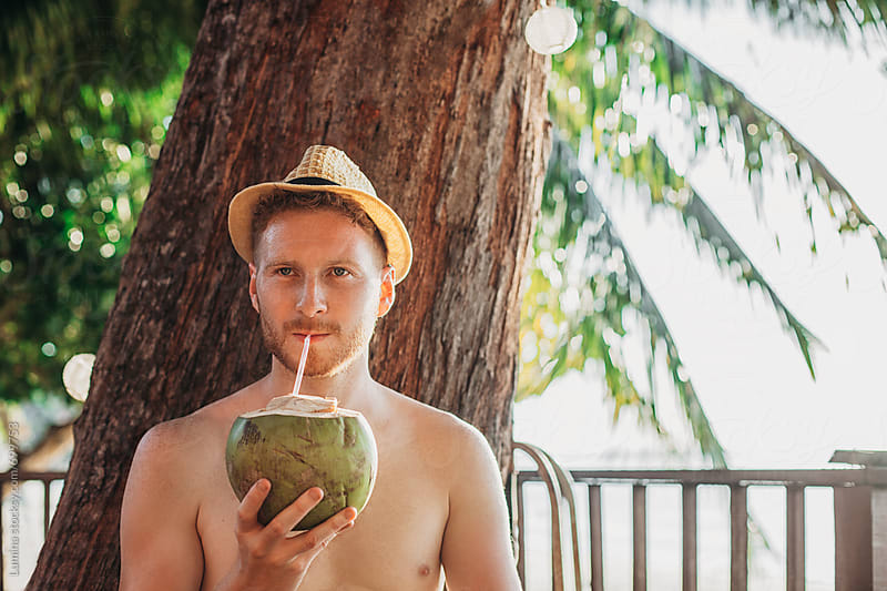 Man Drinking Fresh Coconut Water by Lumina for Stocksy United