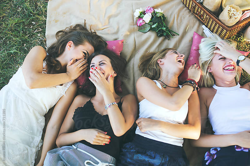 Four happy female friends having fun outside in nature by Jovana Rikalo for Stocksy United