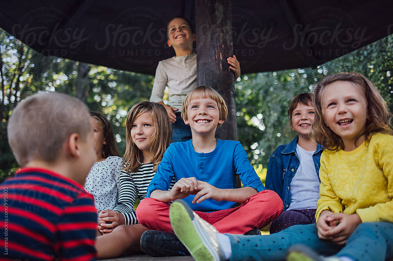 Kids Playing Outdoors by Lumina for Stocksy United