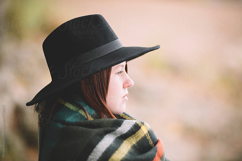Young woman with black hat by Vesna for Stocksy United