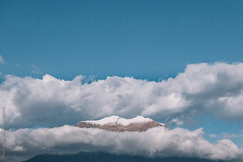 Mountain rising from the clouds by Alberto Bogo for Stocksy United