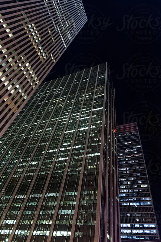 kycrapers and towers in manhattan skyline view at night by Gabriel Diaz for Stocksy United