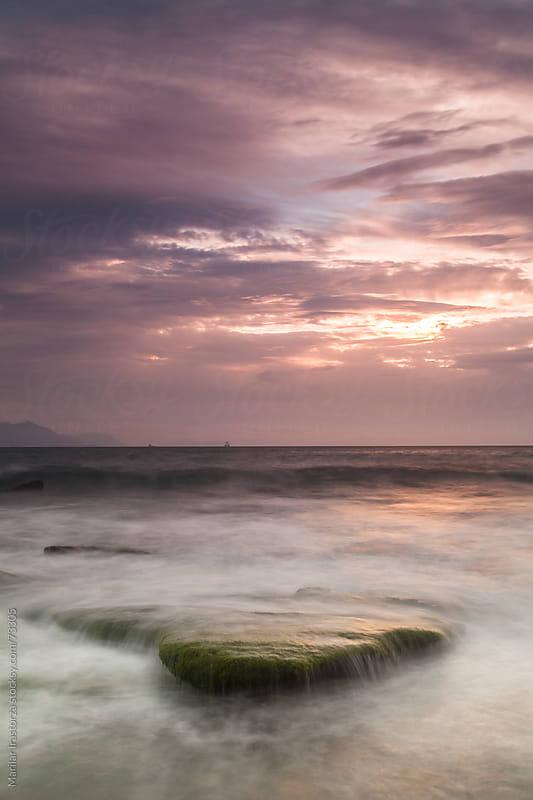 Sunset on the beach Azkorri, in the Basque Country (Spain) by Marilar Irastorza for Stocksy United