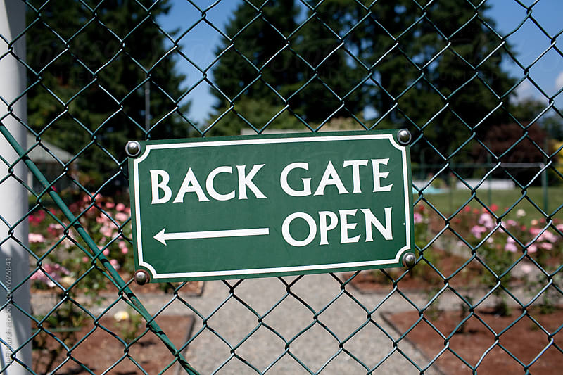Back gate open sign by Jeff Marsh for Stocksy United