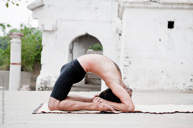 Man doing yoga by Christine Love Hewitt for Stocksy United