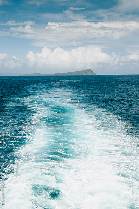 Ferry wake and island, Samoa. by Thomas Pickard for Stocksy United