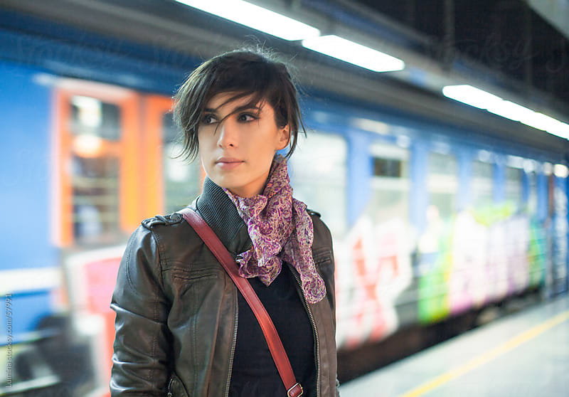 Young Woman at the Train Station by Lumina for Stocksy United