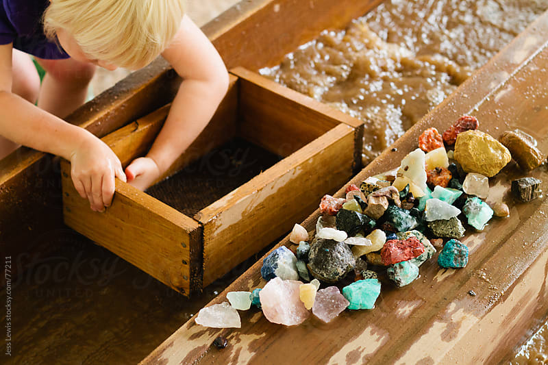 child mining for gemstones by Jess Lewis for Stocksy United