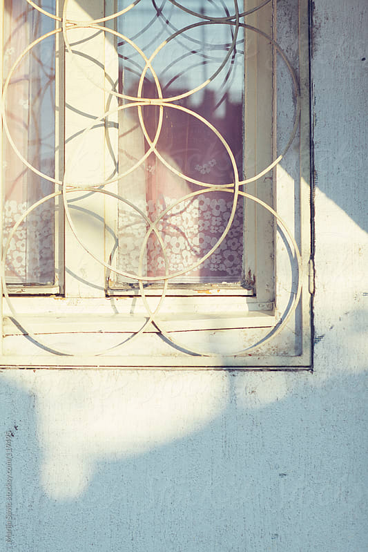 Close up of an old window in morning light. by Marija Savic for Stocksy United