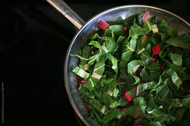 Cooking Rainbow Swiss Chard On The Stove by ALICIA BOCK for Stocksy United