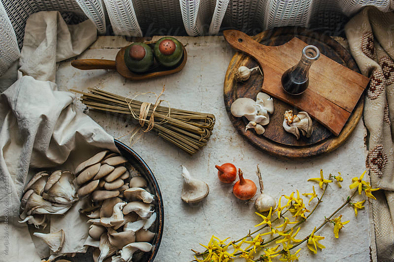 Different food ingredients on white rustic table by Marija Savic for Stocksy United