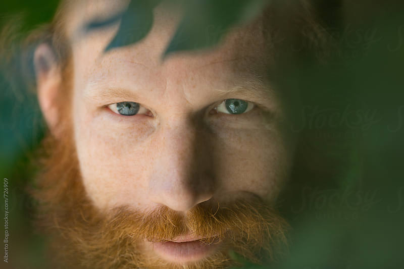 Portrait of smiling Man with red beard by Alberto Bogo for Stocksy United