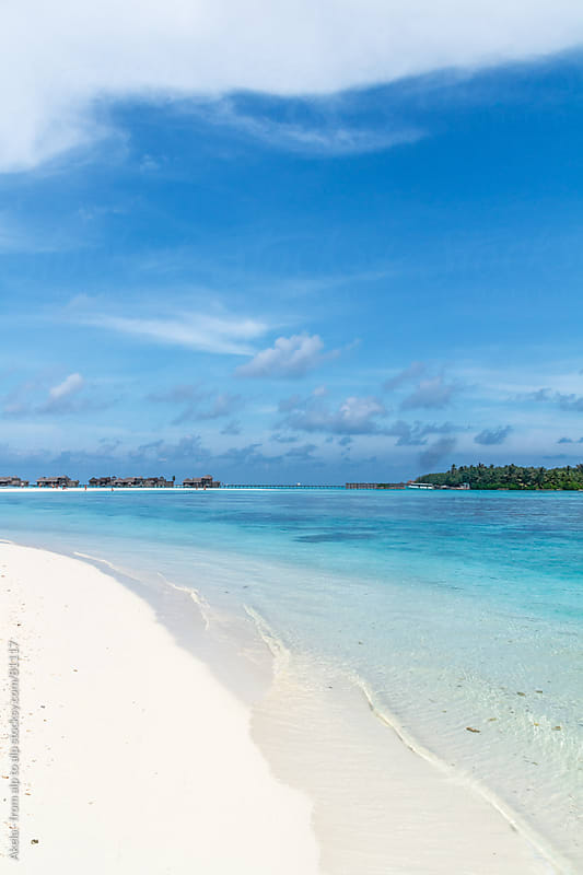 watervillas on a white sanded beach on an island on the maledive by Leander Nardin for Stocksy United