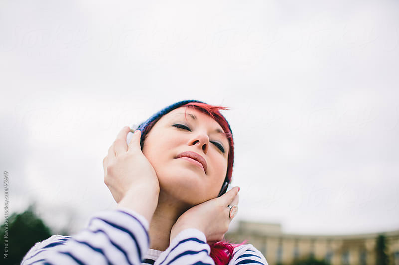 Girl listening to music by michela ravasio for Stocksy United