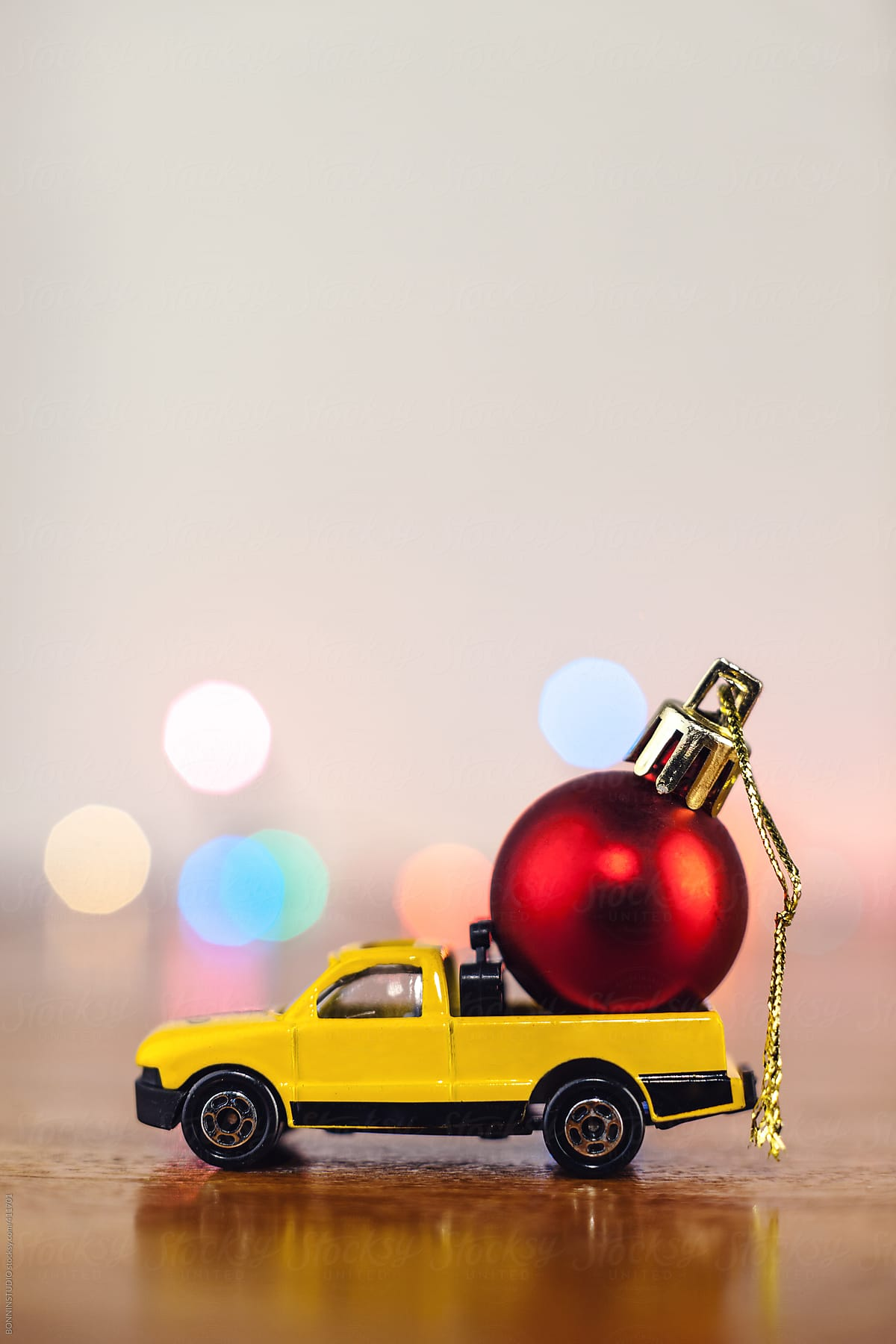 Christmas Red Ball On Yellow Toy Car Stocksy United