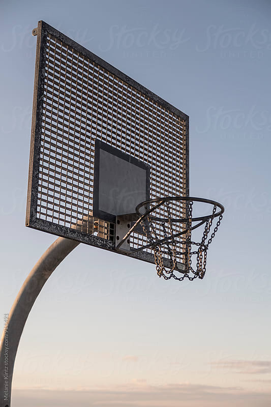 Empty outdoors basketball backboard by Melanie Kintz for Stocksy United