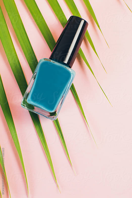 Blue nail polish bottle from above.  by BONNINSTUDIO for Stocksy United