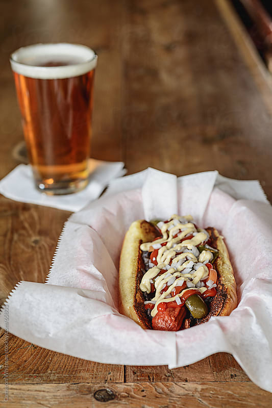 Bar Food: Gourmet Hot Dog And Beer by Cameron Whitman for Stocksy United