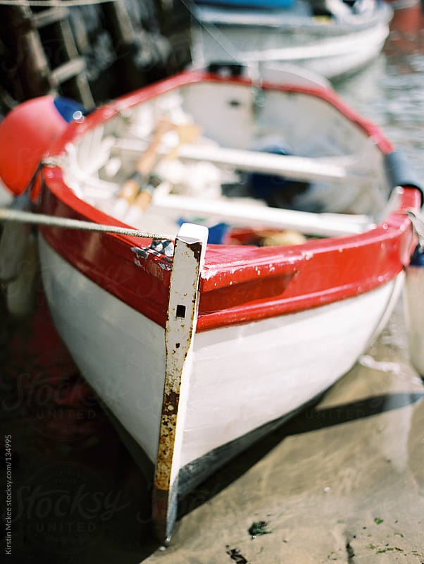 Red fishing boat in Clovelly by Kirstin Mckee for Stocksy United