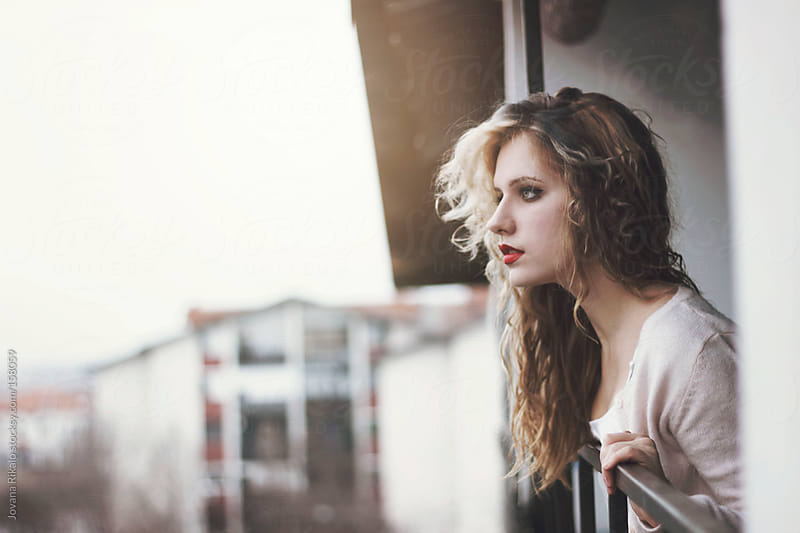 Beautiful girl on terrace by Jovana Rikalo for Stocksy United