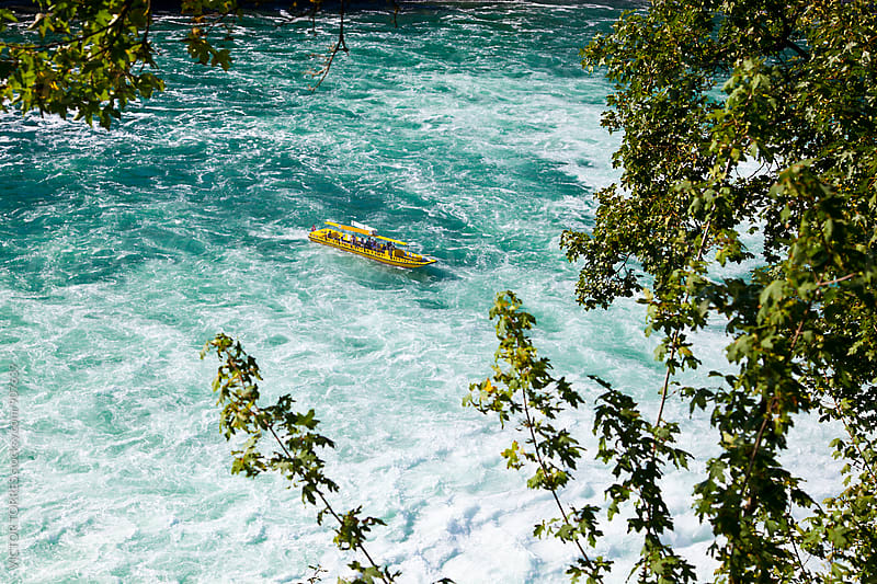 Boat approaching the Rhine Falls by Victor Torres for Stocksy United