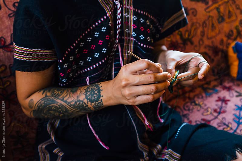 Close Up of a Tattooed Thai Woman Knitting by Nemanja Glumac for Stocksy United