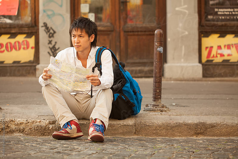 Japanese Tourist Checking the Map on the Street by Mosuno for Stocksy United