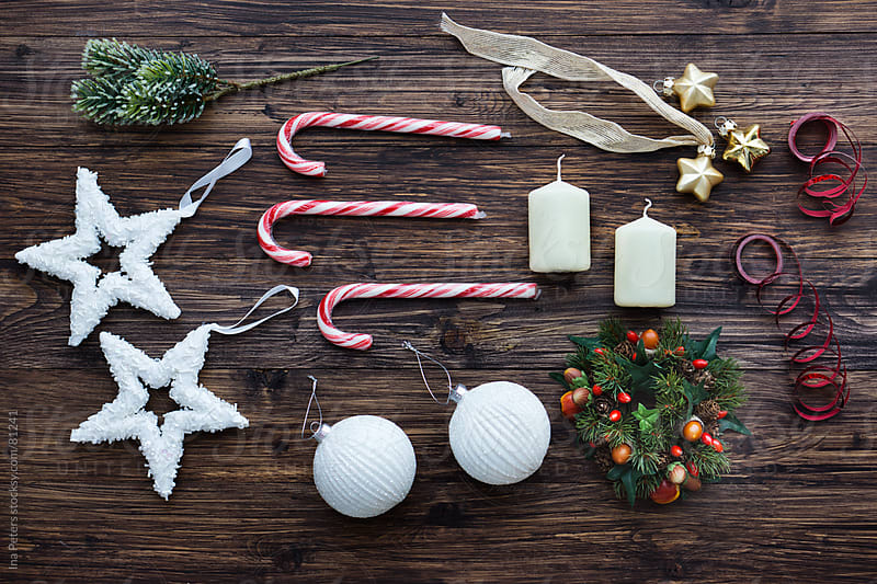 Christmas Decorations Equipment on wooden table by Ina Peters for Stocksy United