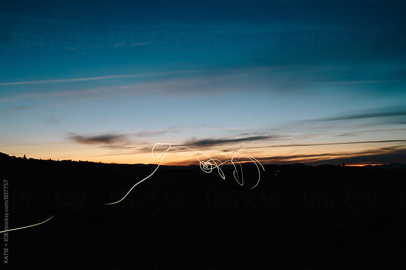 light streaks at sunset by KATIE + JOE for Stocksy United