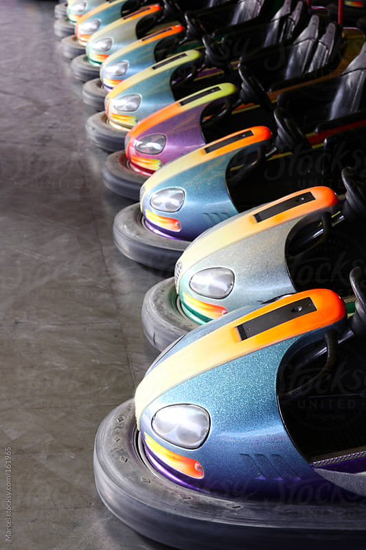 Row of bumper cars by Marcel for Stocksy United