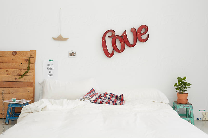 Bedroom with decoration for young couple by Miquel Llonch for Stocksy United