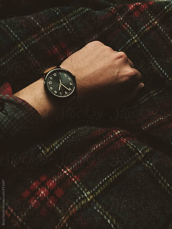 Man Looks At His Watch by Benj Haisch for Stocksy United