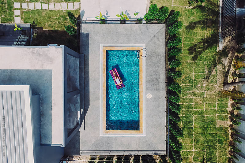 Overhead View of a Woman in a Swimming Pool by Lumina for Stocksy United