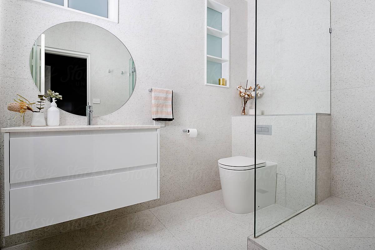 Terrazzo Tiled Bathroom With Round Mirror | Stocksy United