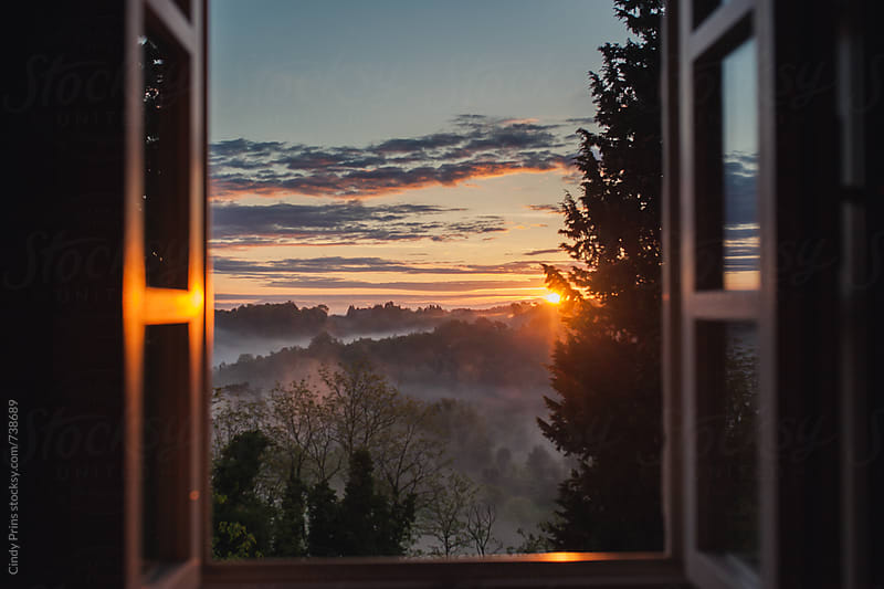 View from the window at sunrise in Tuscany by Cindy Prins for Stocksy United