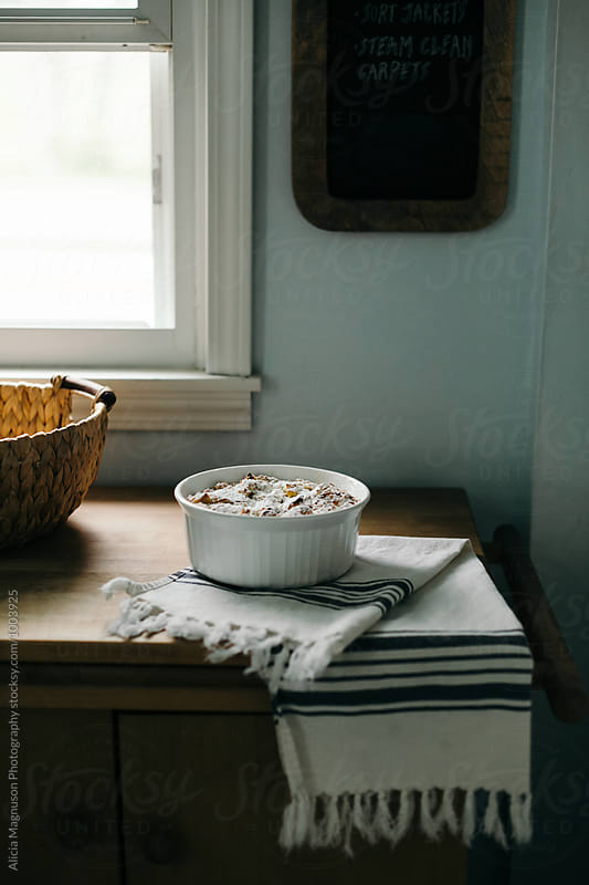 Bread Pudding on Counter by Alicia Magnuson Photography for Stocksy United
