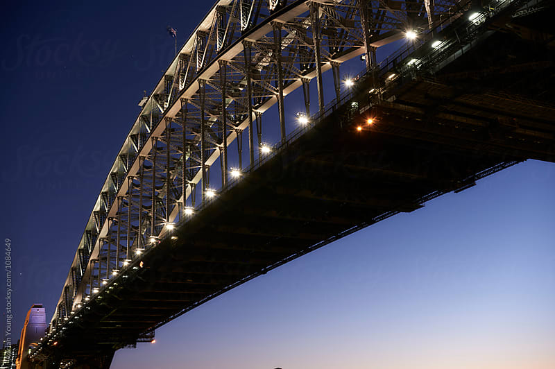 Sydney Harbour Bridge At Dusk by Adrian P Young for Stocksy United