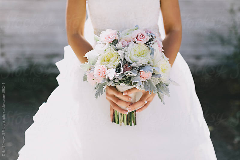 Stock photo of a bride holding her bouquet by Dylan M Howell Photography for Stocksy United