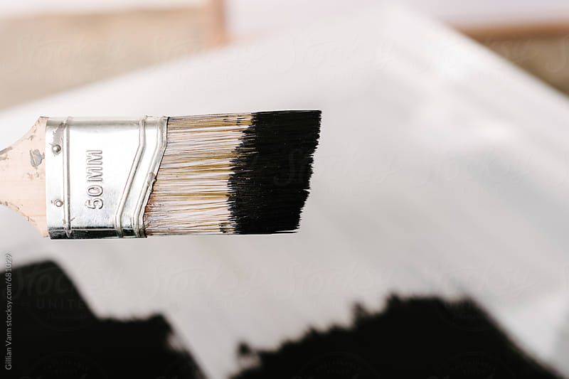 blackboard paint on a brush by Gillian Vann for Stocksy United
