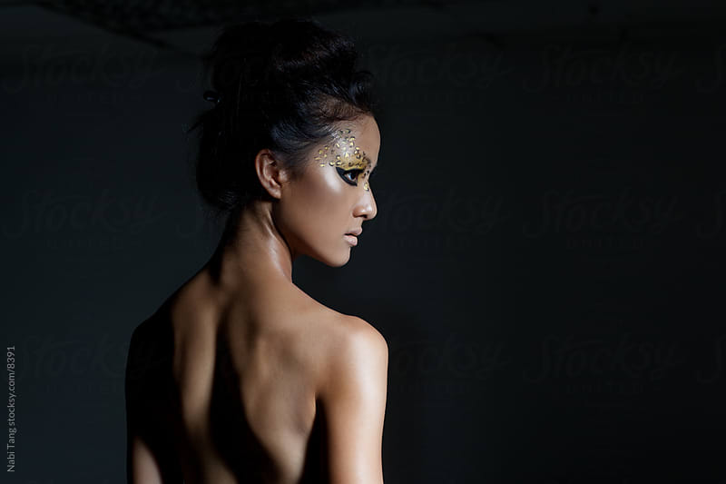 Dark beauty leopard woman in the shadow by Nabi Tang for Stocksy United