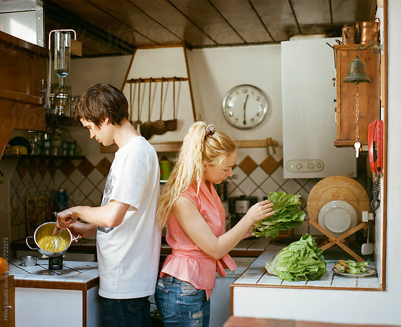 Couple cooking by Milles Studio for Stocksy United
