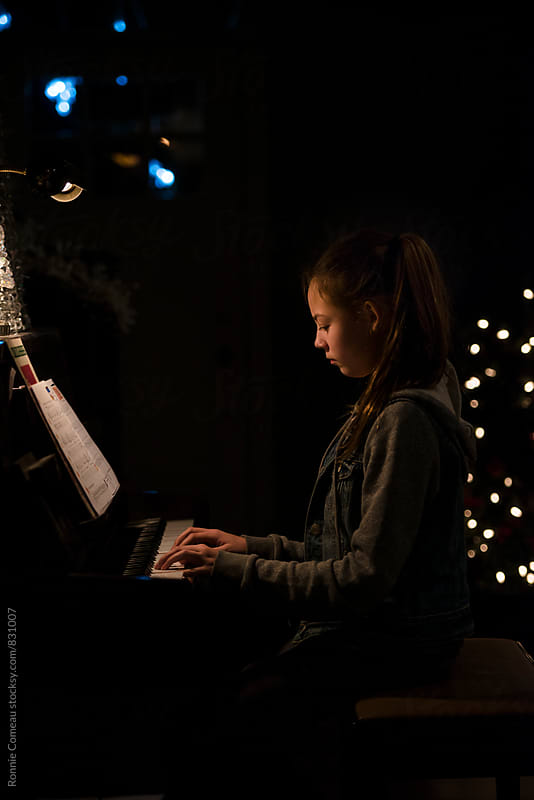 Preteen Girl Playing Piano by Ronnie Comeau for Stocksy United