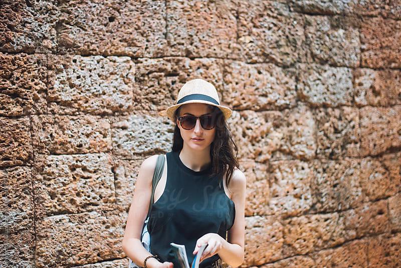 Female Caucasian Tourist Reading Travel Guide  by Nemanja Glumac for Stocksy United