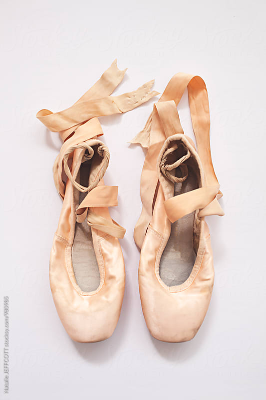 Weathered and well worn pair of ballet shoes by Natalie JEFFCOTT for Stocksy United