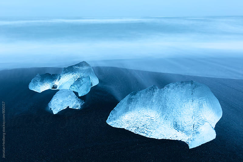 Blocks of ice on a black sand beach by Jonatan Hedberg for Stocksy United