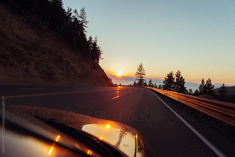 Highway Driving at Sunset by VISUALSPECTRUM for Stocksy United