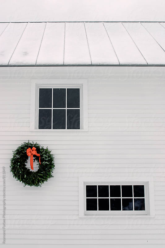Wreath on Barn in Vermont, USA by Raymond Forbes LLC for Stocksy United