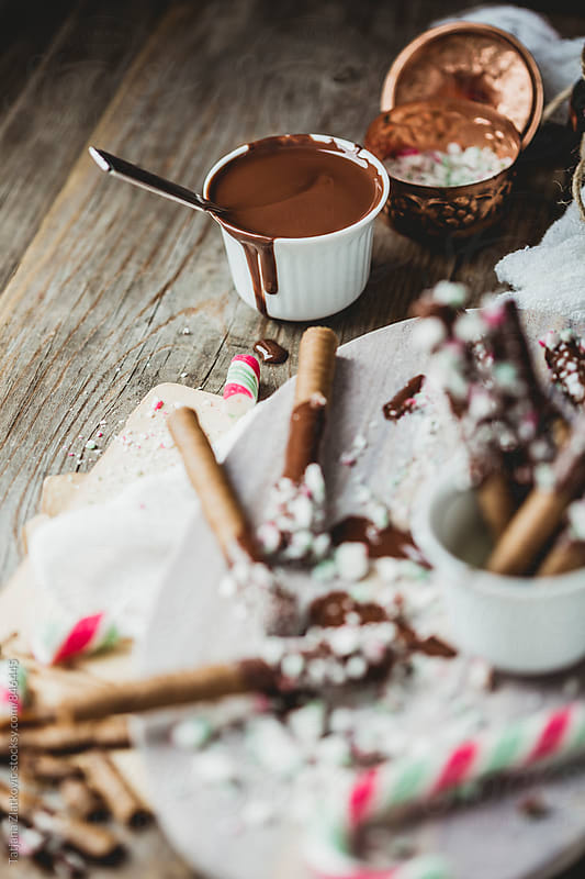 Cigarette cookies with chocolate and Christmas candies by Tatjana Ristanic for Stocksy United